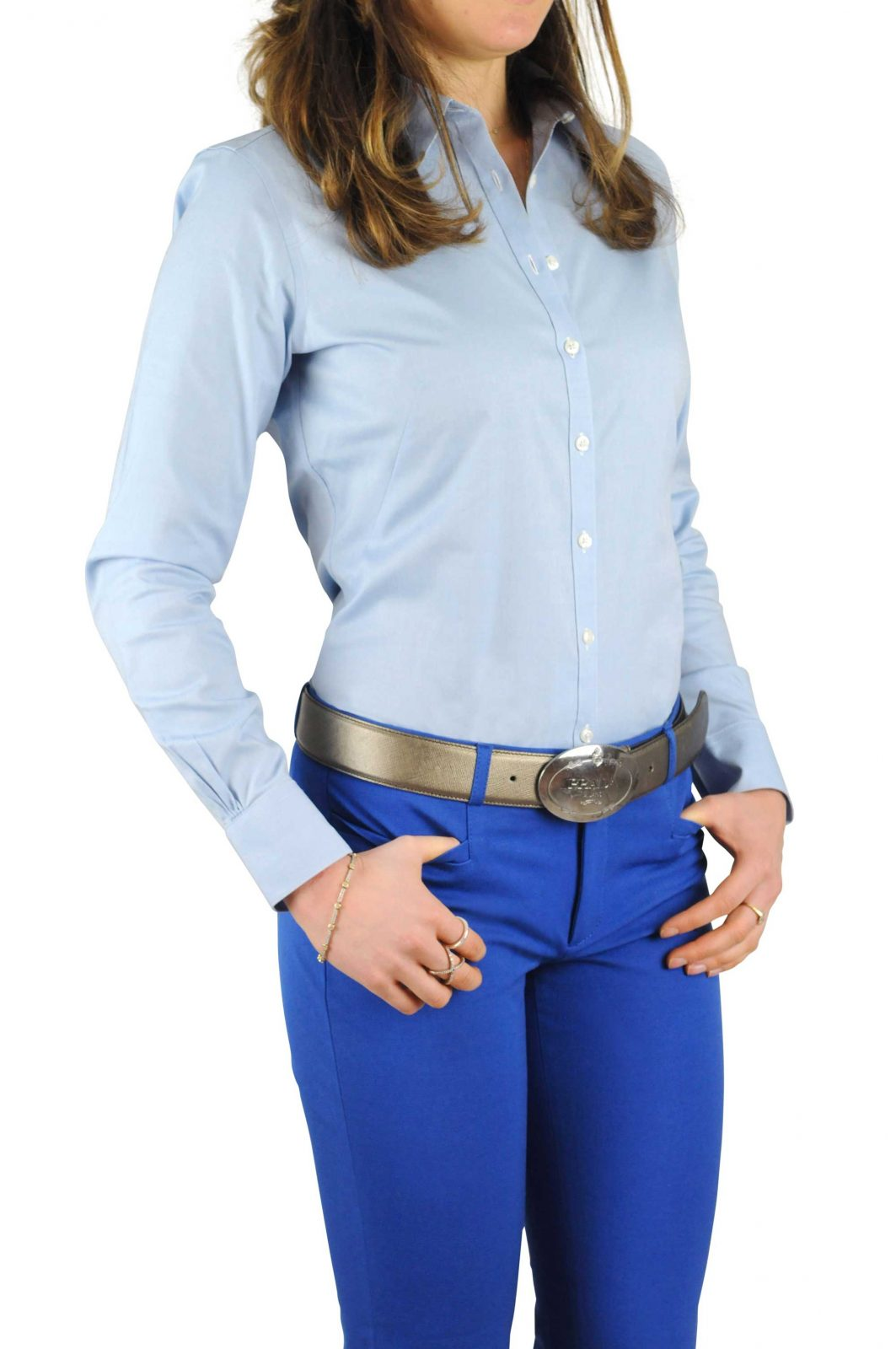 Woman confidently wears Tuck-N-Stay to keep her crisp pressed blue shirt tucked into her pants
