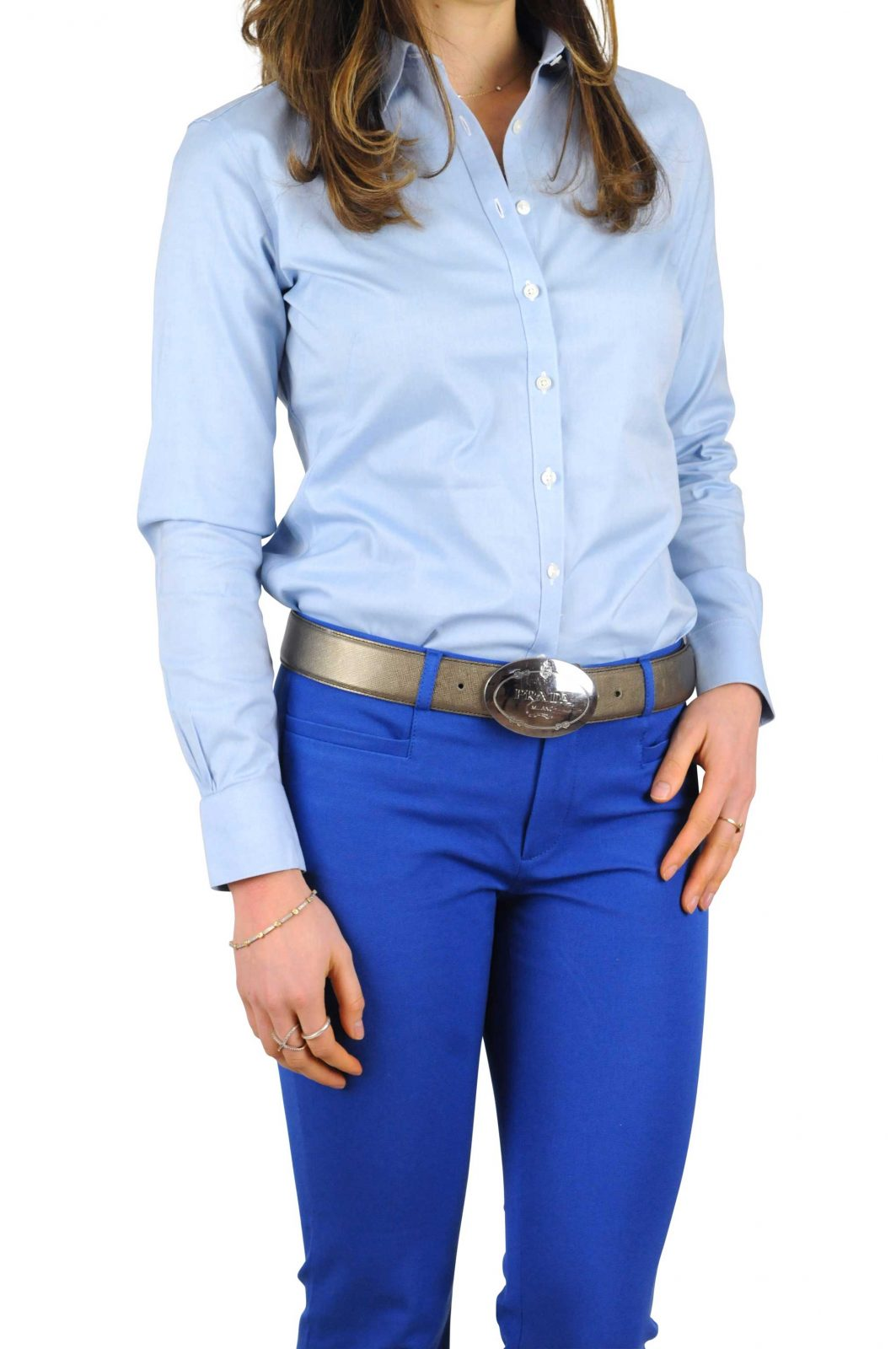 Woman in blue shirt and pants with a sloppy untucked appearance