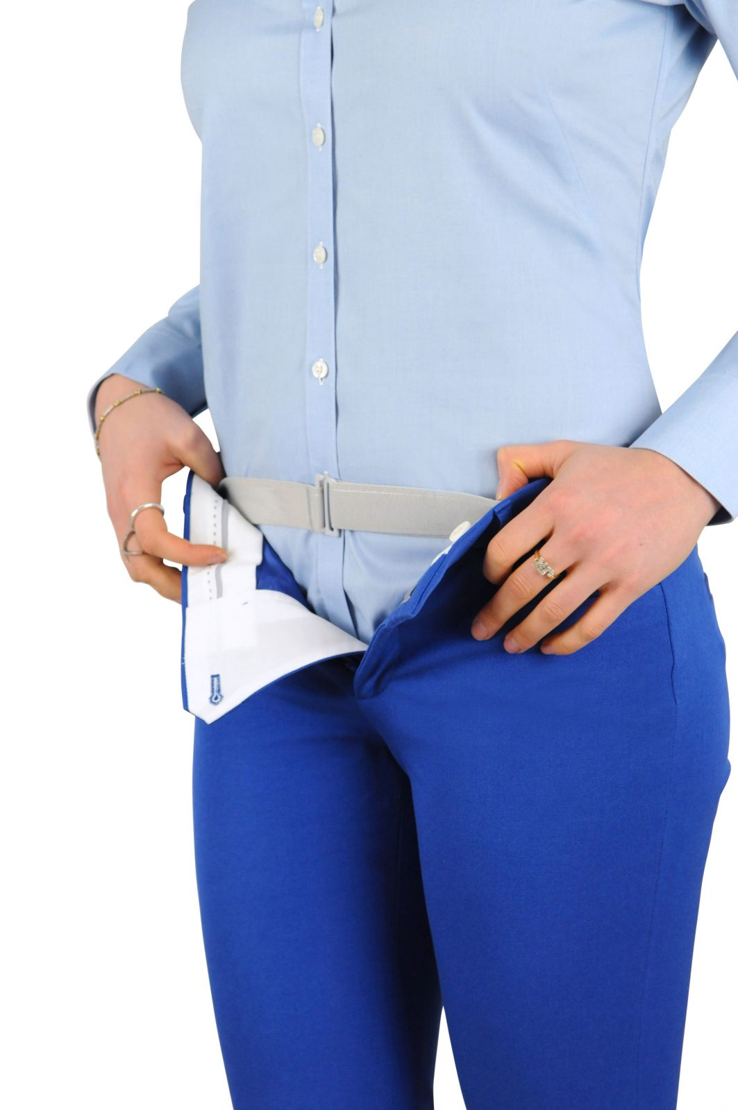 Woman wearing Tuck-N-Sta under her pants but over her shirt keeping her shirt neatly tucked all day